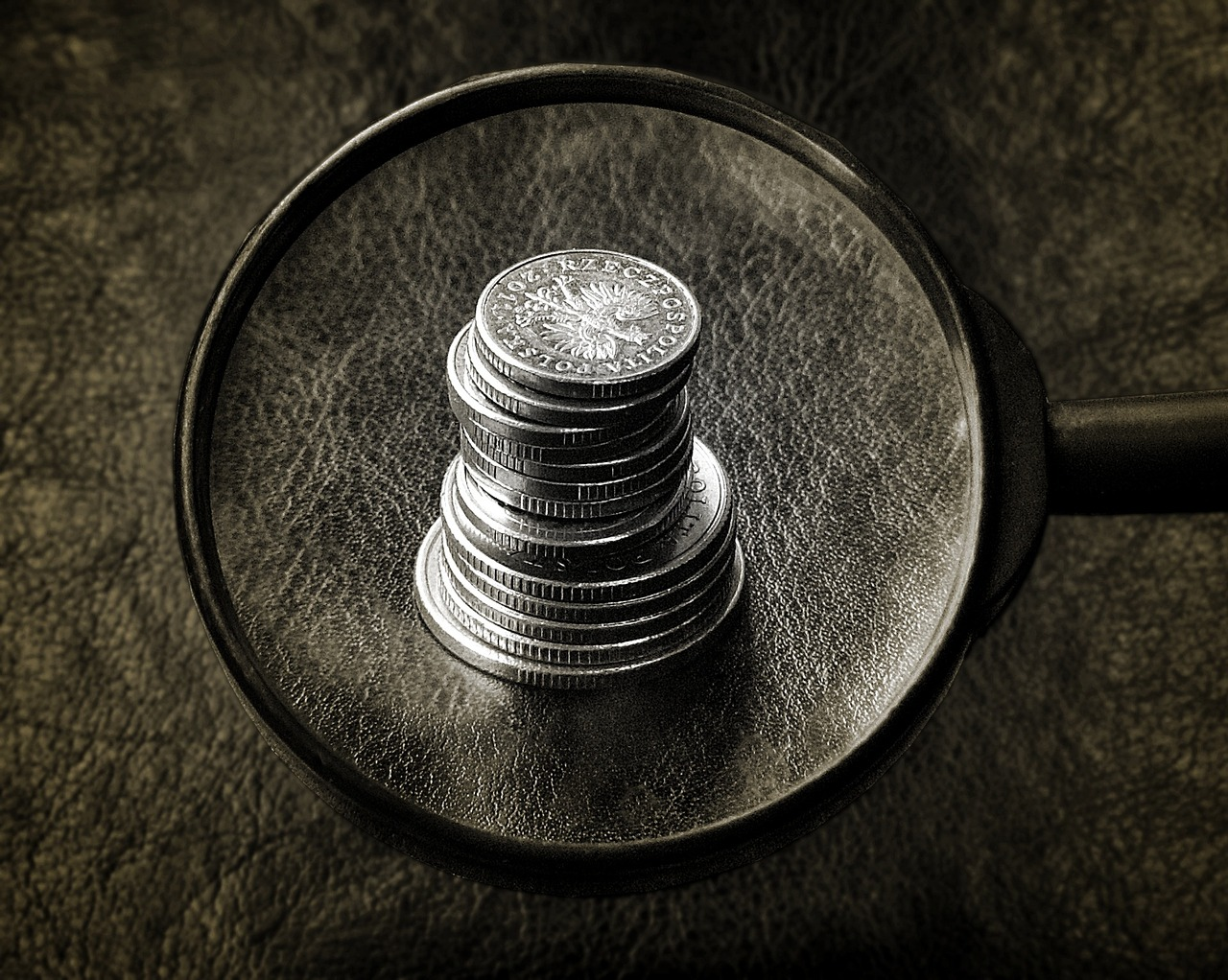 Magnifying glass of a stack of coins