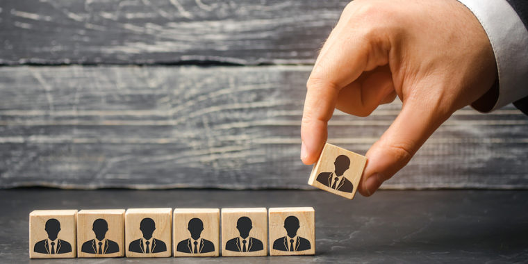 The Leader Builds Team From Cubes With Employees. Businessman In