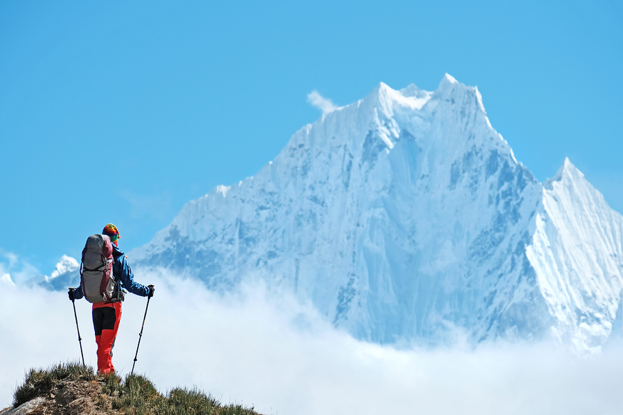 Hiker With Backpacks Reaches The Summit Of Mountain Peak. Succes