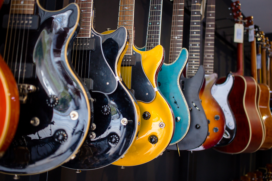 Row Of Electric Guitars In A Music Instruments Shop. Parts Of Gu