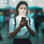Privacy-first martech: Business woman with face obscured uses website