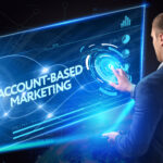 Man interacts with virtual account-based marketing screen